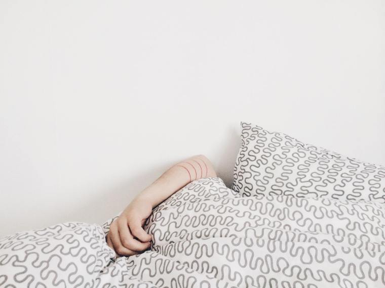 Woman with no motivation lays in bed
